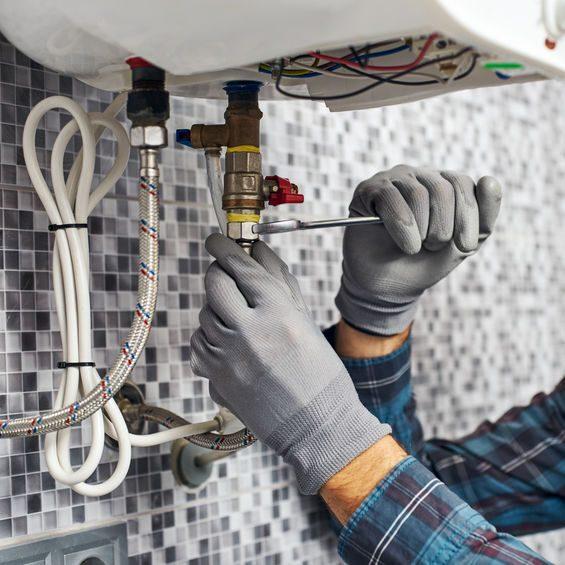 Worker repairing water heater